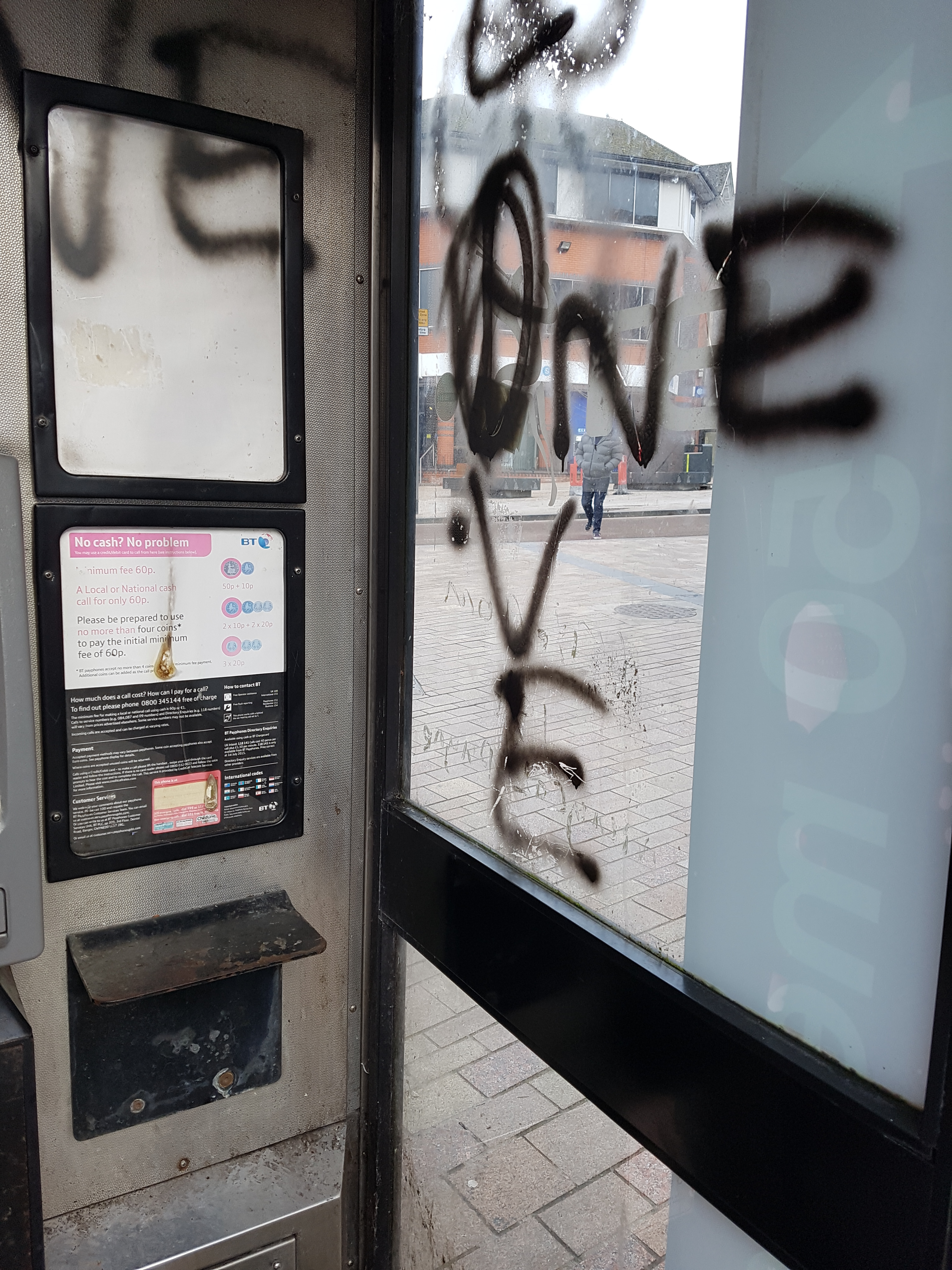 Requested to clean and remove graffiti from busy city centre phonebox